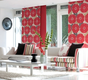 This room comes together beautifully with the unexpected gorgeous pop of floral red drapery.  The stripes in the pillows bring the design together with the black pillows grounding the design.