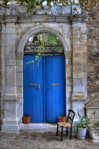These doors at a Greek abode make a simple but beautiful statement.  The rich royal blue doors add just the pop of color to draw you in.  The simplistic stone and  architectural arch in additional to the greens cascading down the door make for an beautiful compilation.